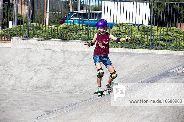 Skater girl carves at the skatepark