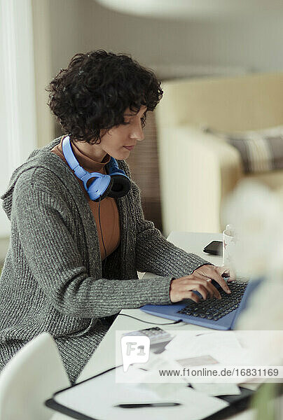Woman working from home at laptop