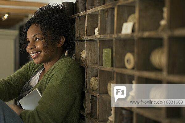 Happy female shop owner at vintage display