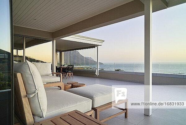 Luxury home showcase patio with tranquil scenic ocean view