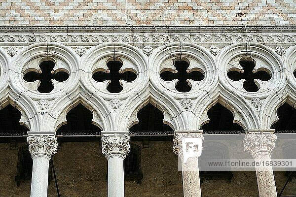 Detail of the intricate colonnade on the facade of Doge's Palace. Venice. Italy.
