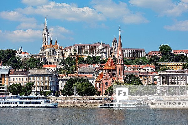 View across the river Danube to the historic buildings in Buda with Matyas church  Fishermen's Bastion and Calvin's church in Budapest - Hungary.