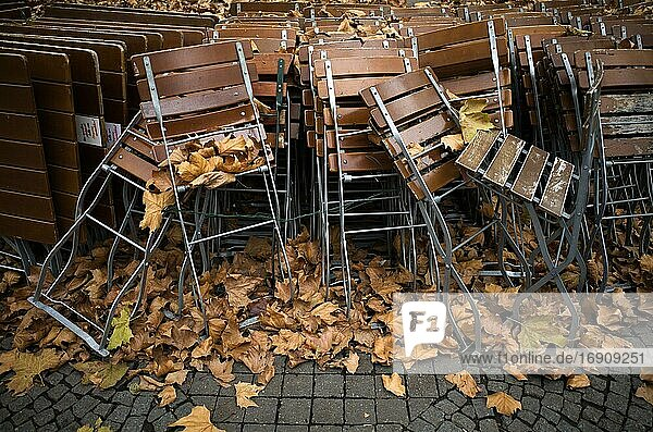 Tables and chairs of a closed beer garden in autumn leaves  second  hard lockdown  Corona crisis  Stuttgart  Baden-Württemberg  Germany  Europe