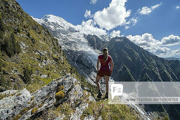 Hiker looking at mountain landscape  view of glacier Glacier de Taconnaz  hiking La Jonction  Chamonix  Haute-Savoie  France  Europe