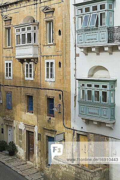 Old architectural apartmrnt building facades with Maltese balconies  Valletta  Malta.