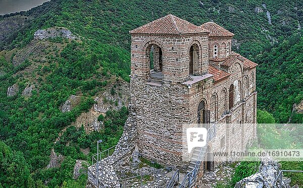 Asenovgrad  Bulgaria 24. 07. 2019. Church of the holy mother of God in the Asens Fortress surrounded Bulgarian Rhodope mountains on a cloudy summer day.