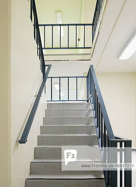 Stairwell with a metal handrail.