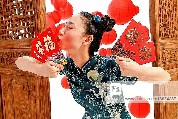 The New Year happy woman with a red envelope