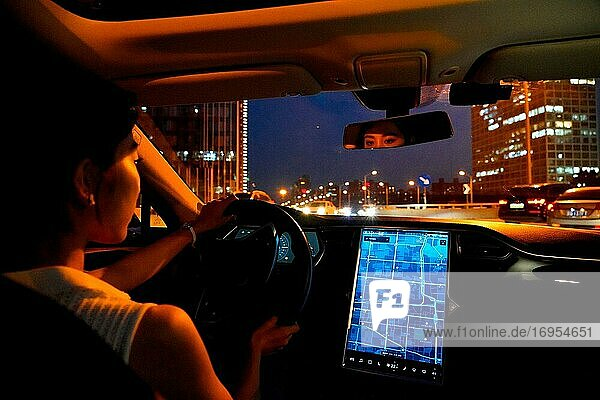 According to the map screen to drive at night young woman