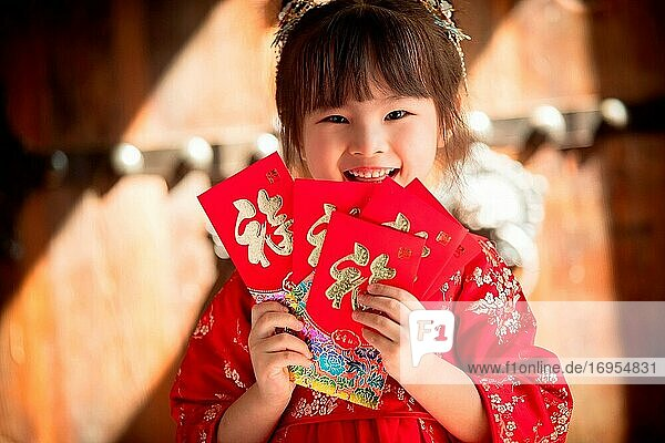 Cute girl with a red envelope