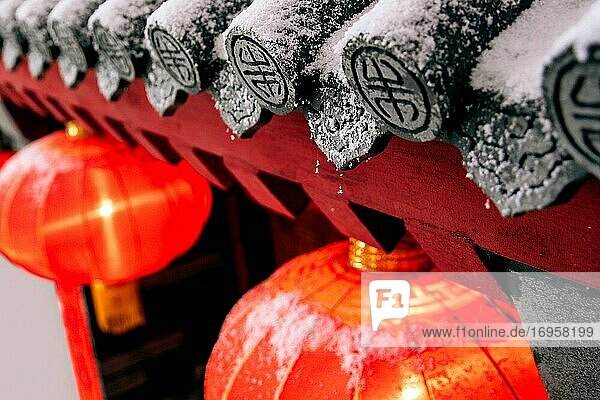 The snow under the eaves of red lanterns