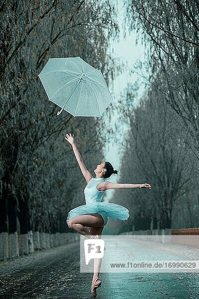 The young woman with an umbrella dance ballet