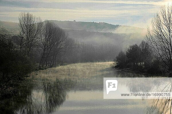 A misty and frozen winter dawn by the Sabor river  at the village of Gimonde  Portugal.