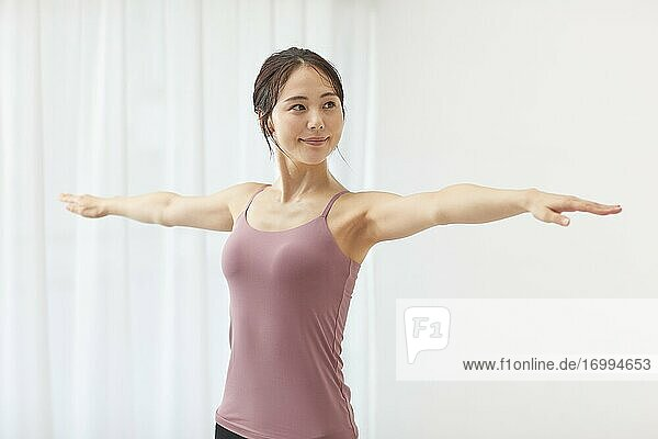 Healthy Japanese woman training at home