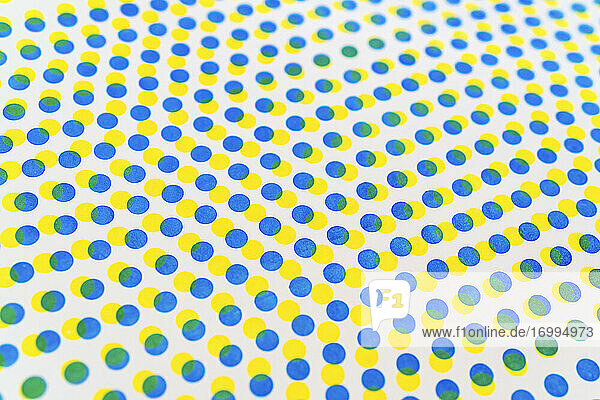 3D blue and yellow dots pattern overlapping on white background