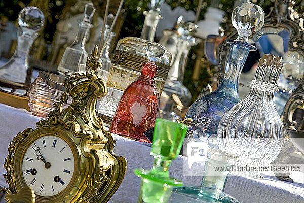 Antique clock and carafes at flea market