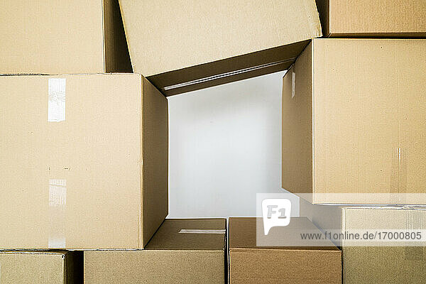 Stack of cardboard boxes against wall