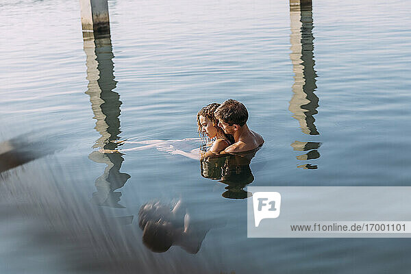 Affectionate young couple bathing in the sea