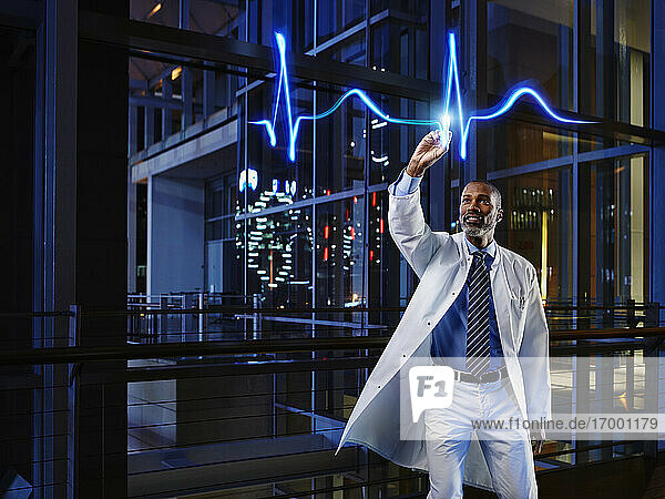 Male cardiologist analyzing pulse trace at hospital