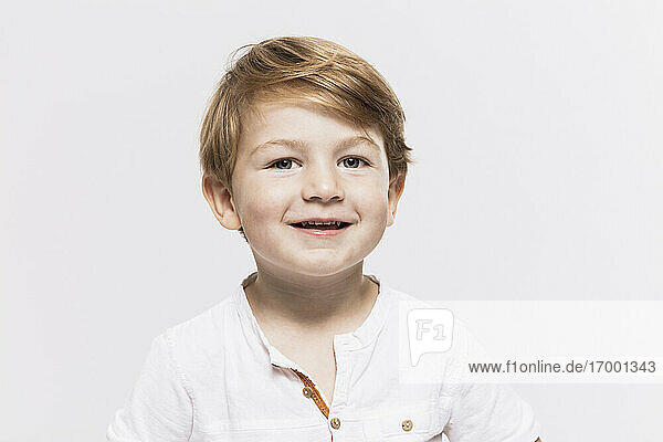 Cute boy against white background
