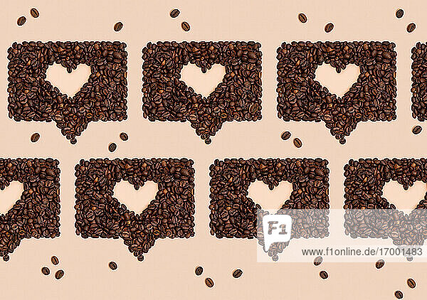 Pattern or roasted coffee beans arranged into shapes of hearts inside online chat bubbles