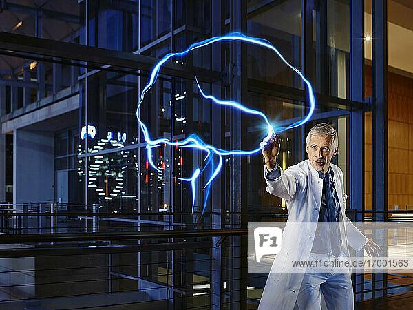 Male neurologist examining brain at laboratory in hospital