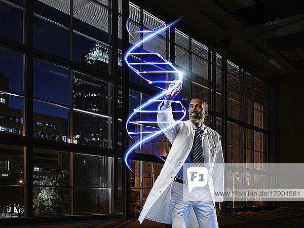 Mature male doctor light painting DNA in laboratory at hospital