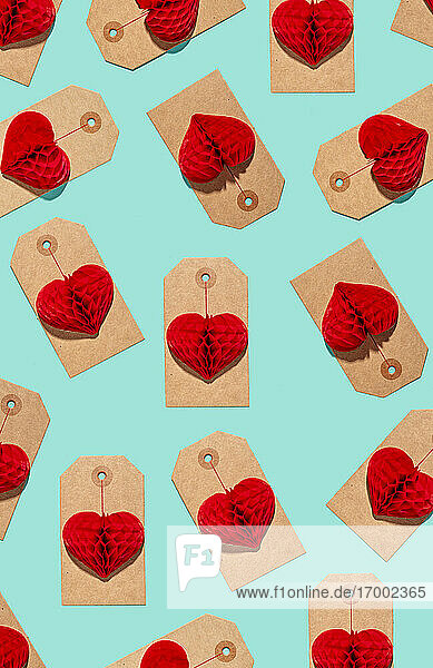 Pattern of labels with heart shaped paper craft decorations