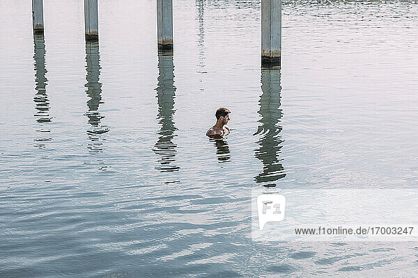Young man bathing in the sea