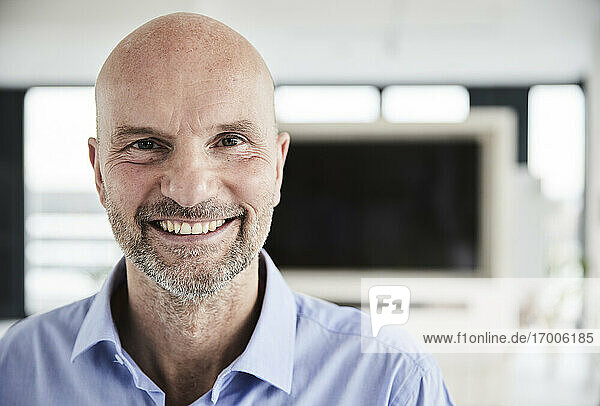 Businessman smiling while standing at home