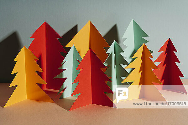 Studio shot of simple paper craft forest trees in autumn colors