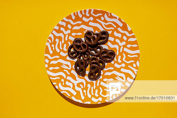 Studio shot of plate with chocolate pretzels