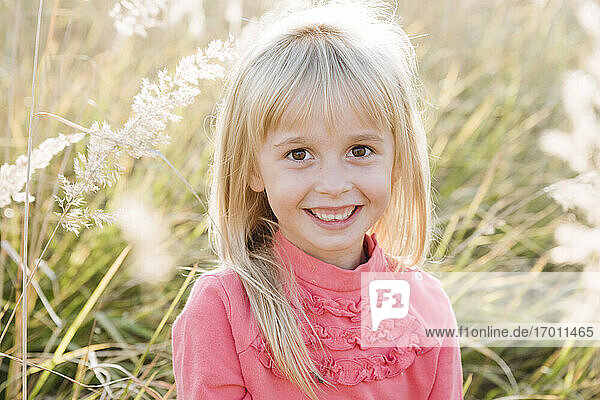 Smiling cute girl in agricultural field