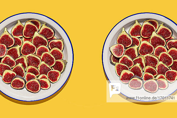 Studio shot of two plates with halved figs