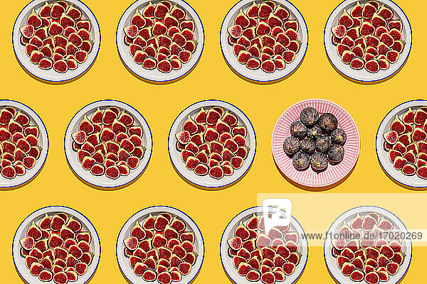 Pattern of plates with fresh halved figs