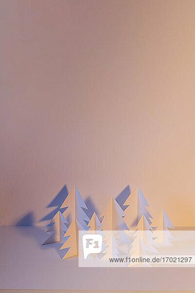 Studio shot of white paper craft trees
