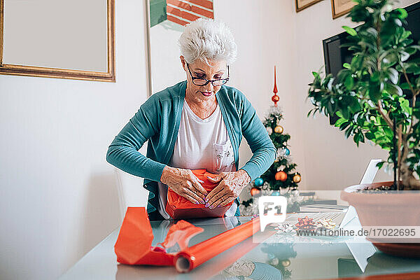 Woman wrapping Christmas Property Released (PR)esents