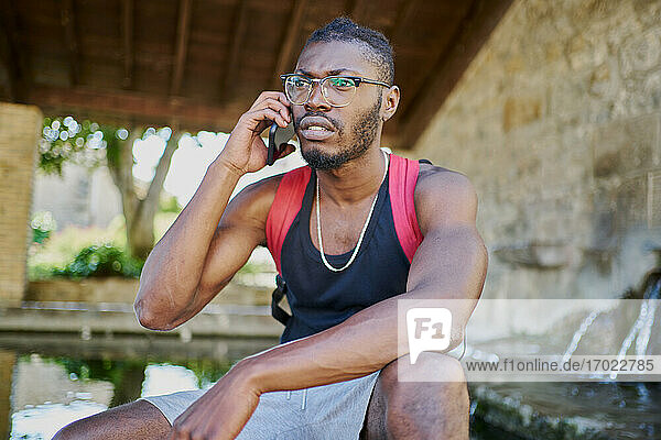 Young man on phone call outdoors