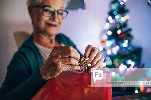 Woman wrapping Christmas Property Released (PR)esent