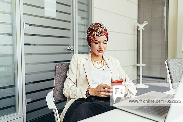 Businesswoman using smartphone in office