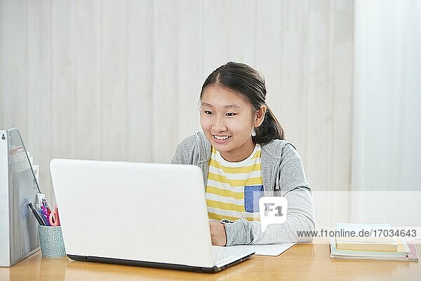Japanese junior high schoolgirl studying remotely