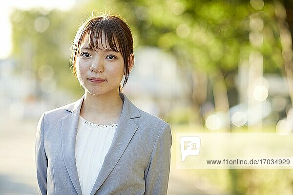 Young Japanese businesswoman outside