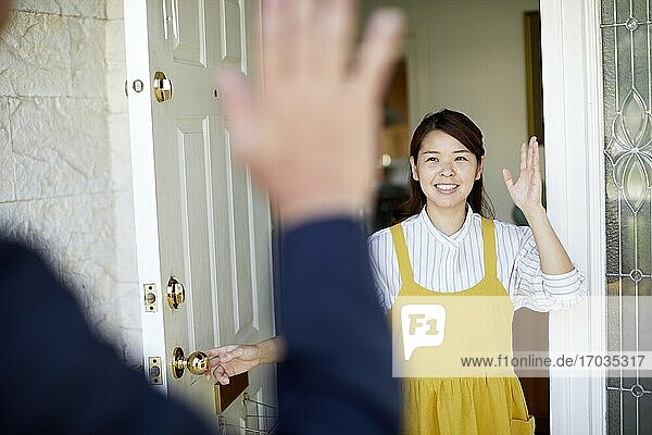 Happy Japanese woman at home