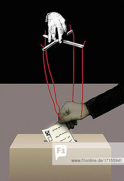 Puppenspieler manipuliert die Stimmabgabe eines Menschen