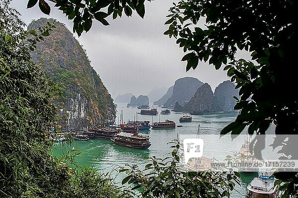 Ha Long bay  Vietnam. The first of our 2 days in Halong Bay. This is the view down from the ?suprising caves?  the first stop on the tour. I loved out boat ? a few English speaking people and a large Vietnamese family celebrating their New Year?about 4 hours of solid Karaoke?and they bought us a drink!
