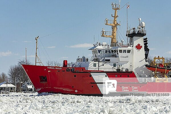 Roberts Landing  Michigan - The Canadian Coast Guard icebreaker Samuel Risley breaks up ice on the St. Clair River. Bitter cold has led to ice jams on the river and flooding in shoreline communities. The St. Clair River is the border between the U. S. and Canada  it drains the upper Great Lakes towards Lake St. Clair and on to Lake Erie.