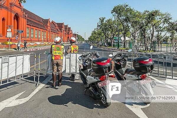 Bangkok  Thailand - December 7  2019: Police with motorcycle resguard tourist area near The Grand Palace in Bangkok  Thailand.