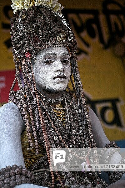 Sadhu baba covered with Rudraksh  the tears of Shiva  encampment on the ghats of B?nares waiting for shivaratri  UP  india.