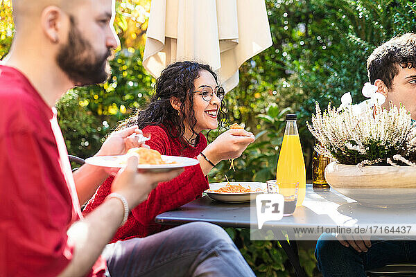 Friends eating meal together outdoors