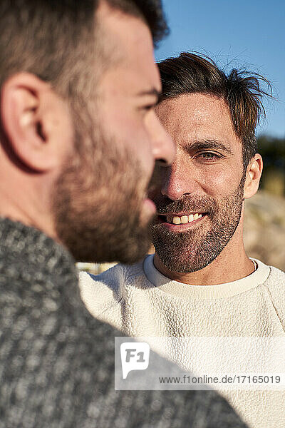 Close-up of smiling man with boyfriend
